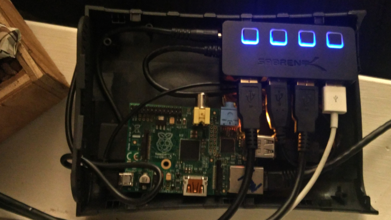 Raspberry pi and Sabrent USB hub in a plastic hard drive enclosure